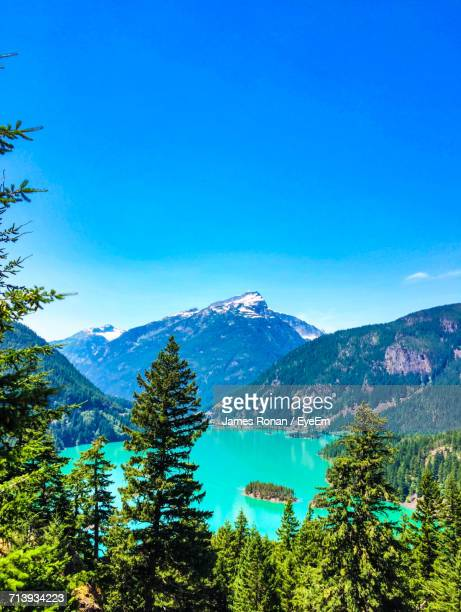 scenic view of mountains against clear blue sky - diablo lake stock photos and pictures