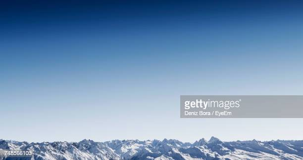 scenic view of mountains against clear blue sky - panorama stock-fotos und bilder