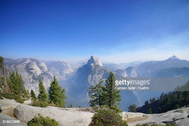 scenic view of mountains against clear blue sky - yosemite valley stock photos and pictures