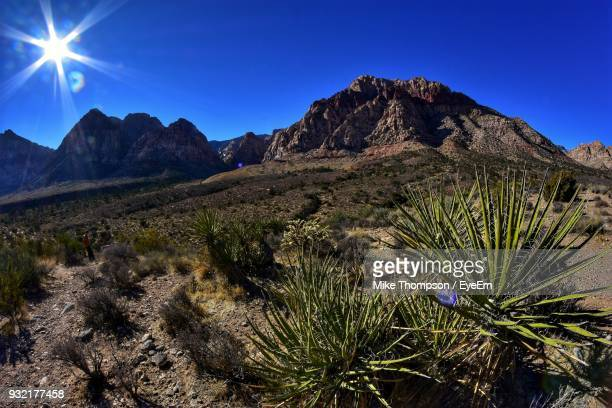 scenic view of mountains against clear blue sky - mt charleston stock photos and pictures