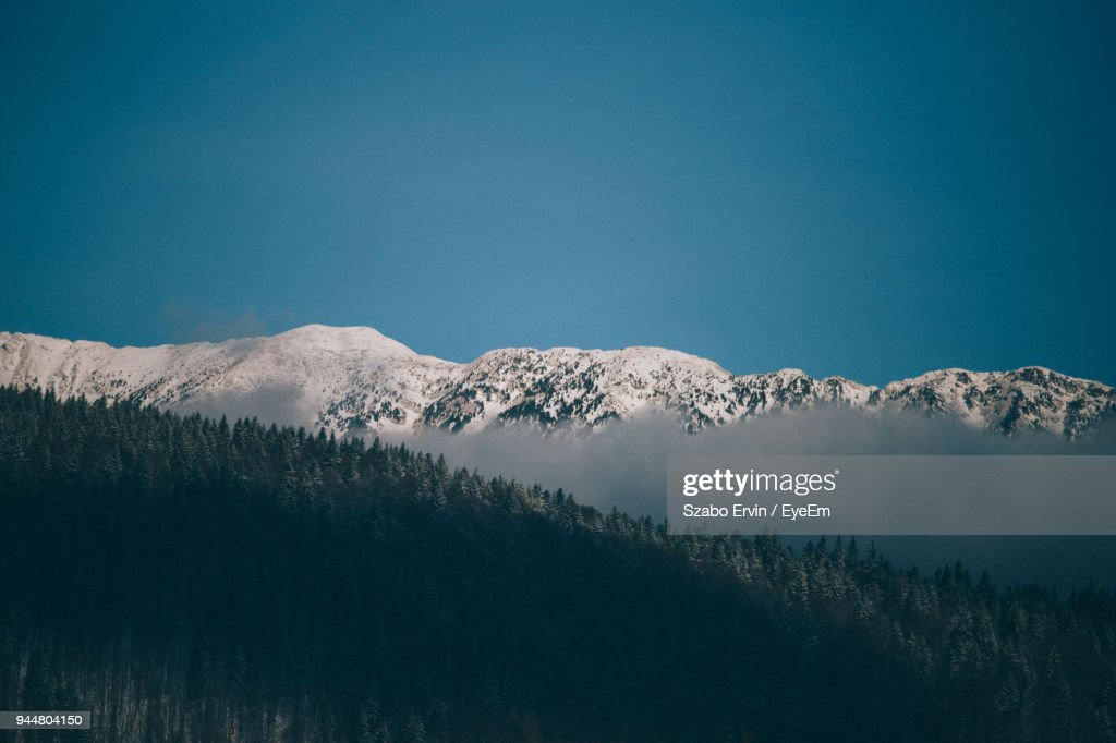 Scenic View Of Mountains Against Clear Blue Sky : Stock Photo