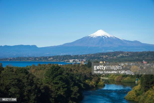 scenic view of mountains against clear blue sky - villarrica stock photos and pictures