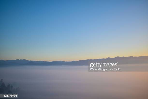 scenic view of mountains against clear sky during sunset - wimol wongsawat stock photos and pictures