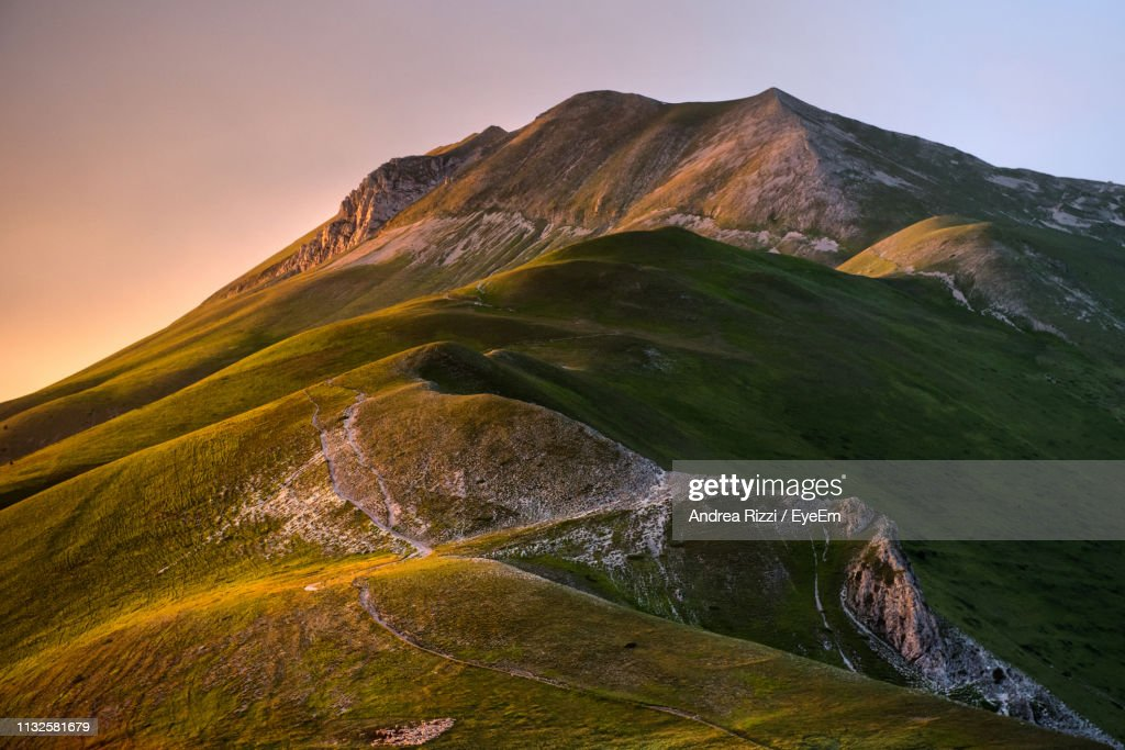 Scenic View Of Mountains Against Clear Sky During Sunset : Foto de stock