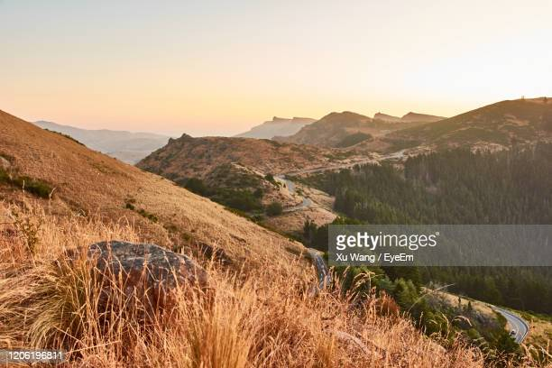 scenic view of mountains against clear sky during sunset - wang he stock pictures, royalty-free photos & images