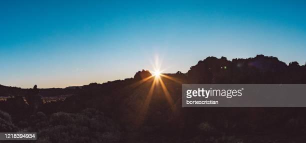 scenic view of mountains against clear sky during sunset - bortes bildbanksfoton och bilder
