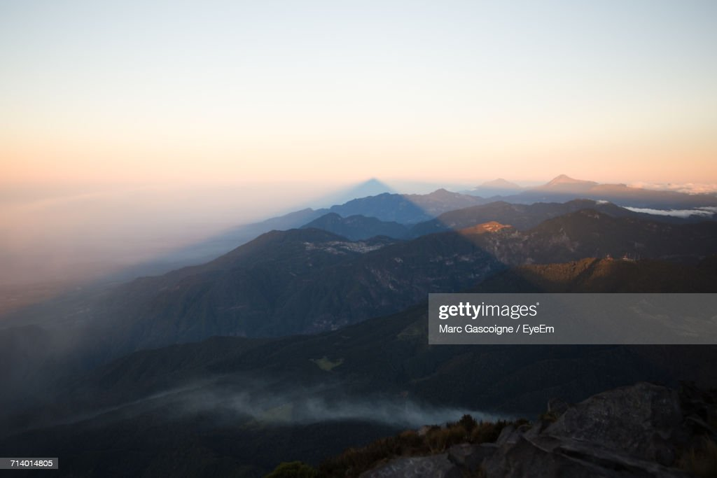 Scenic View Of Mountains Against Clear Sky During Sunset : Stock Photo
