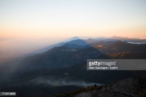scenic view of mountains against clear sky during sunset - quetzaltenango stock-fotos und bilder