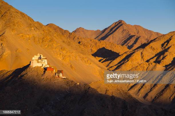 scenic view of mountains against clear sky - indore stock photos and pictures