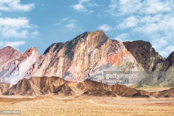 scenic view of mountains against clear sky - rainbow mountains china stock-fotos und bilder