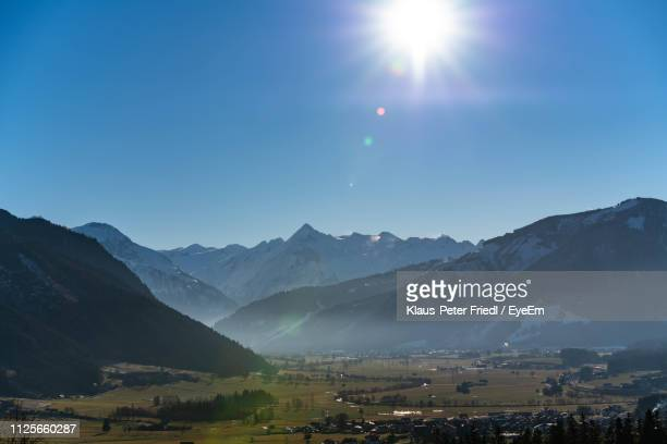 scenic view of mountains against clear sky - saalfelden stock pictures, royalty-free photos & images