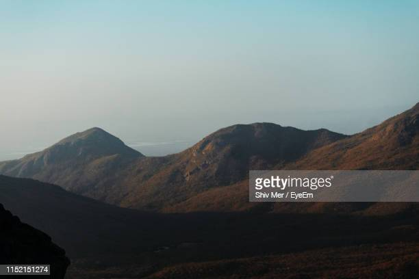 scenic view of mountains against clear sky - junagadh stock photos and pictures