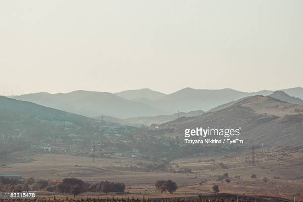 scenic view of mountains against clear sky - nikitina stock pictures, royalty-free photos & images