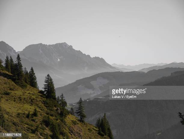 scenic view of mountains against clear sky - leogang stock pictures, royalty-free photos & images