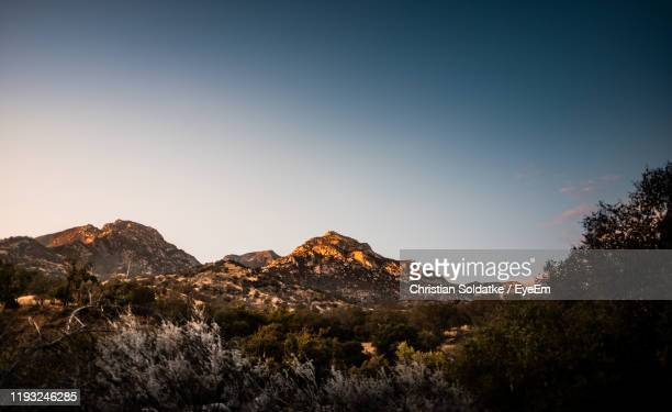scenic view of mountains against clear sky - christian soldatke imagens e fotografias de stock