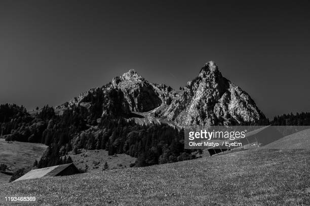 scenic view of mountains against clear sky - schwyz stock pictures, royalty-free photos & images