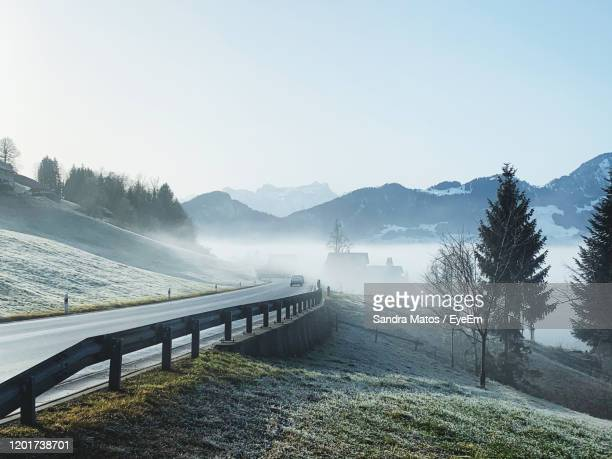 scenic view of mountains against clear sky - leitplanke stock-fotos und bilder