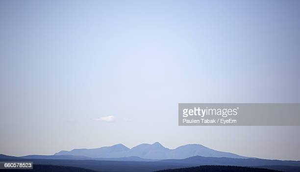 scenic view of mountains against clear sky - paulien tabak foto e immagini stock