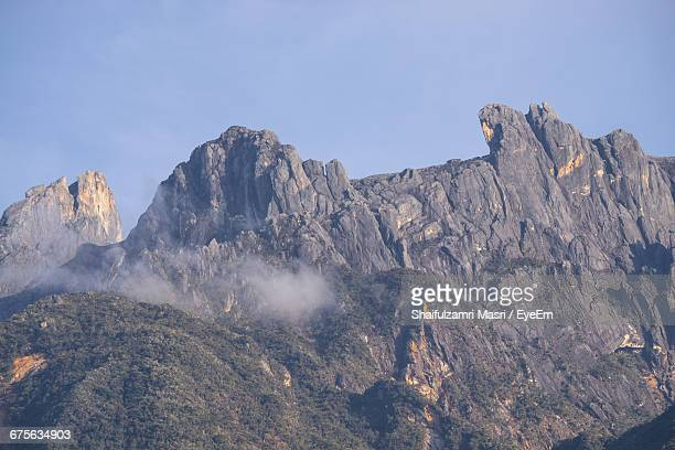 scenic view of mountains against clear sky - shaifulzamri stock pictures, royalty-free photos & images