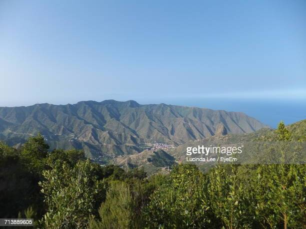 scenic view of mountains against clear sky - lucinda lee stock photos and pictures
