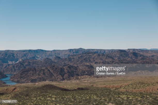 scenic view of mountains against clear sky - boulder city stock photos and pictures