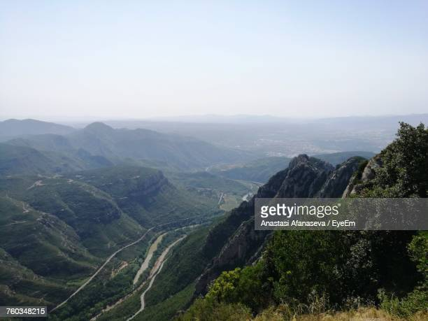 scenic view of mountains against clear sky - anastasi foto e immagini stock