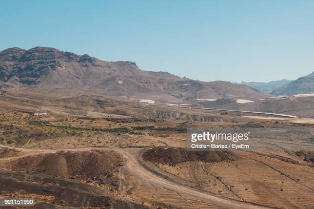 scenic view of mountains against clear sky - bortes stockfoto's en -beelden