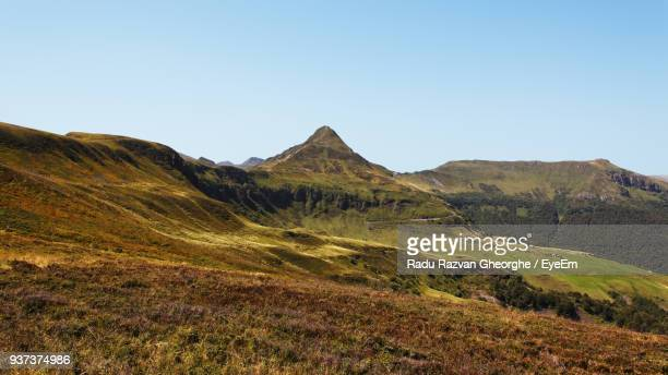 scenic view of mountains against clear sky - cantal stock pictures, royalty-free photos & images