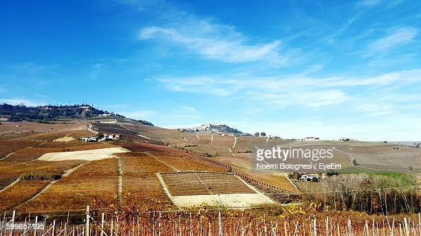 scenic view of mountains against cloudy blue sky - noemi foto e immagini stock