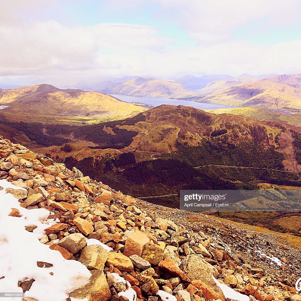 Scenic View Of Mountains Against Cloudy Sky At Ben Nevis : Stock Photo
