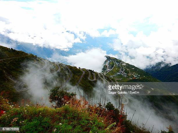 Scenic View Of Mountains Against Cloudy Sky At Darjeeling