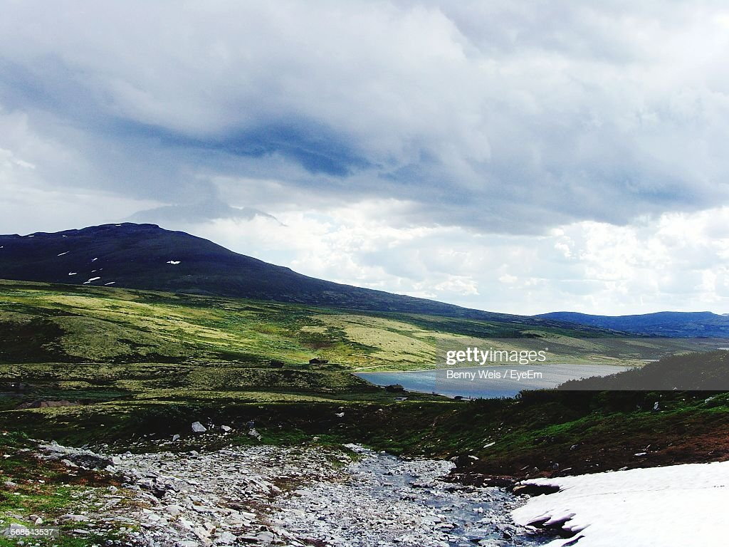 Scenic View Of Mountains Against Cloudy Sky During Winter : Stock Photo