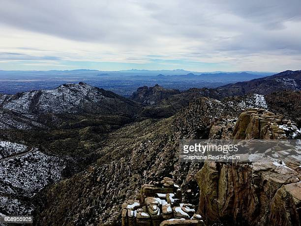 scenic view of mountains against cloudy sky during winter - reid,_wisconsin stock pictures, royalty-free photos & images
