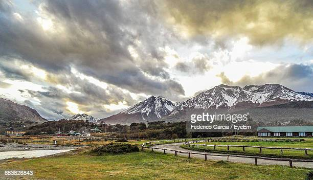 Scenic View Of Mountains Against Cloudy Sky In Winter