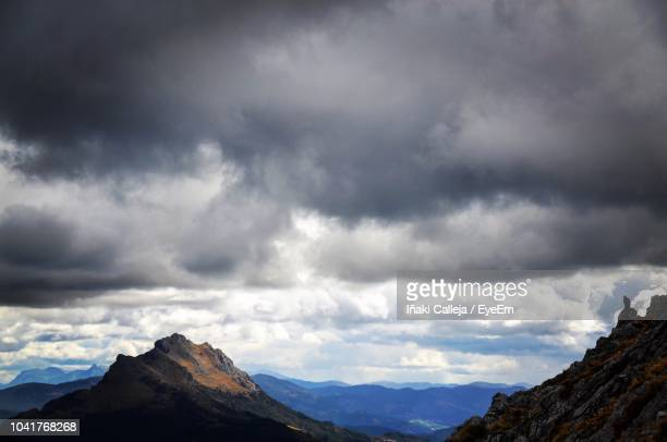 scenic view of mountains against cloudy sky - iñaki mt stock photos and pictures