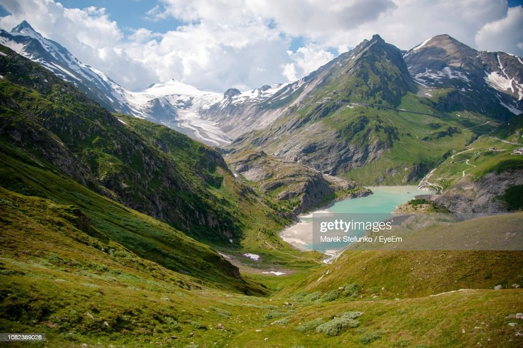 Scenic View Of Mountains Against Cloudy Sky : Stock Photo