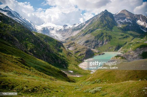 scenic view of mountains against cloudy sky - marek stefunko stockfoto's en -beelden