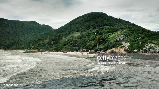 scenic view of mountains against cloudy sky - praia stock pictures, royalty-free photos & images