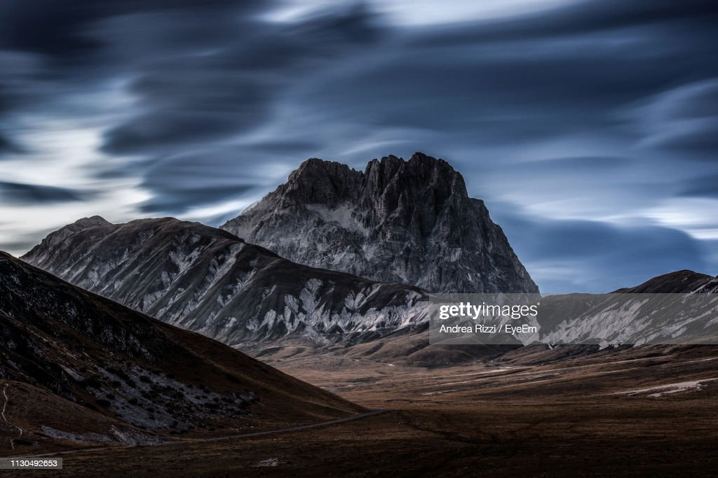 Scenic View Of Mountains Against Cloudy Sky : Foto de stock