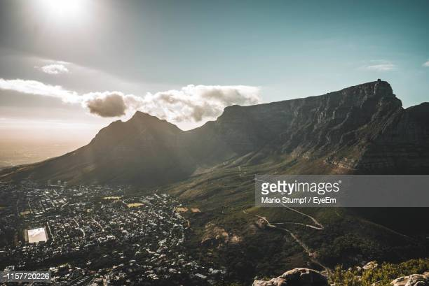 scenic view of mountains against cloudy sky - table mountain stock pictures, royalty-free photos & images
