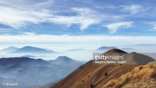 scenic view of mountains against cloudy sky - kosovo stock pictures, royalty-free photos & images