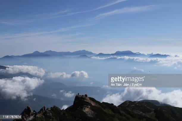 scenic view of mountains against cloudy sky - 長野市 ストックフォトと画像