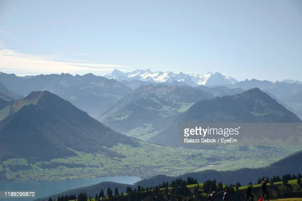 scenic view of mountains against cloudy sky - schwyz stock pictures, royalty-free photos & images