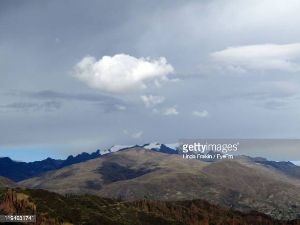 scenic view of mountains against cloudy sky - linda fraikin stock pictures, royalty-free photos & images