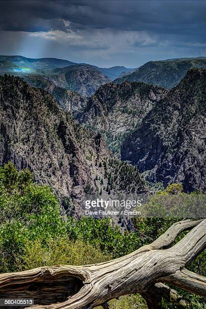scenic view of mountains against cloudy sky - dave faulkner eye em stock pictures, royalty-free photos & images