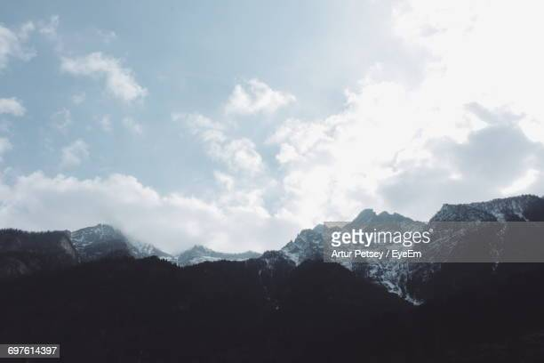 scenic view of mountains against cloudy sky - artur petsey foto e immagini stock