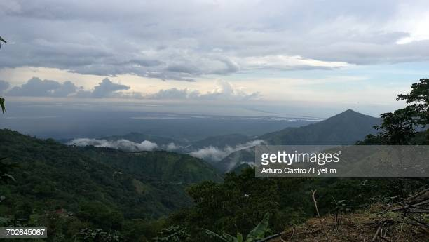 scenic view of mountains against cloudy sky - barranquilla stock photos and pictures