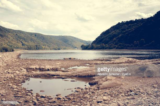 scenic view of mountains against cloudy sky - albrecht schlotter stock photos and pictures
