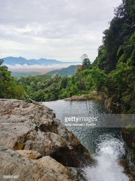 scenic view of mountains against cloudy sky - kuantan stock pictures, royalty-free photos & images