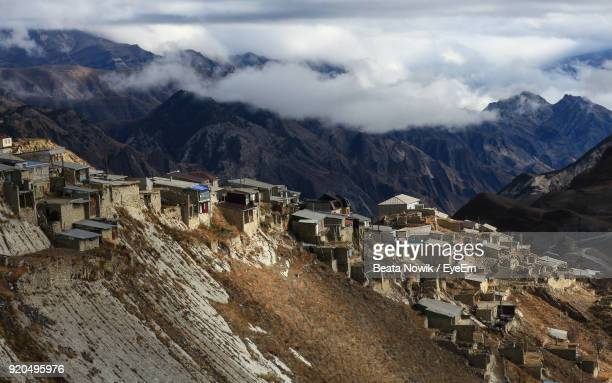 scenic view of mountains against cloudy sky - 北コーカサス ストックフォトと画像